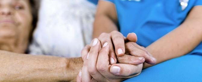 nurse holding elderly persons hand